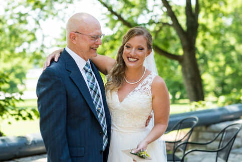 """Lauren and her father share a """"First Look"""" and Lauren pins her dad's boutineer."""