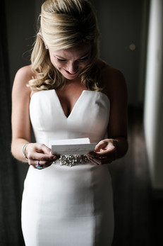 Reading her note from the groom.