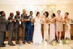 Wedding party posed at bar