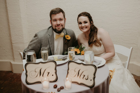 Relaxing at their sweetheart table as guests prepare to dine in the catacombs.  Photos Courtesy of Jacob Photo & Design