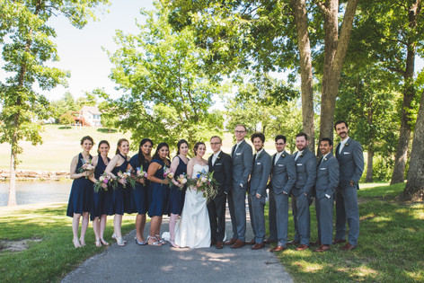 The full wedding party pose for a formal picture before the ceremony. Photo Courtesy of Irish Eyes Photography