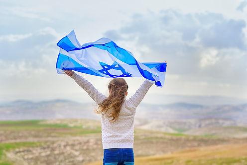 girl with israeli flag.jpeg