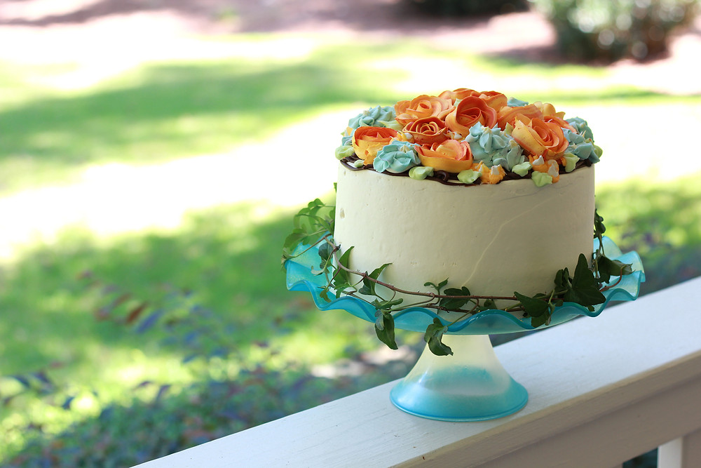A simple buttercream cake with floral accents created by Reva. Photo courtesy Reva Alexander-Hawk)