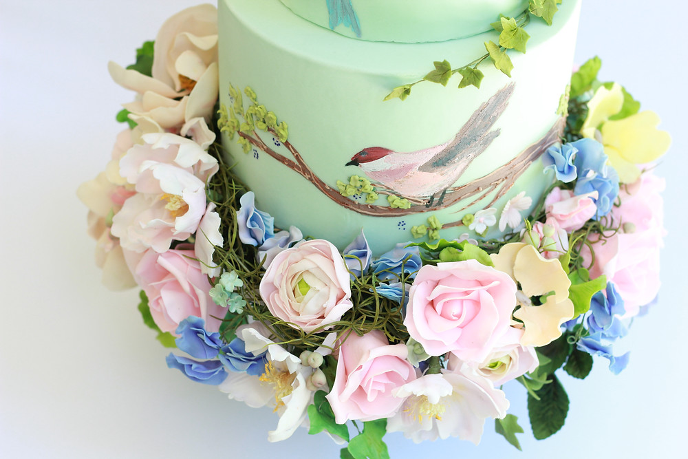 One of Reva's color creations features birds and live florals. Photo courtesy Reva Alexander-Hawk
