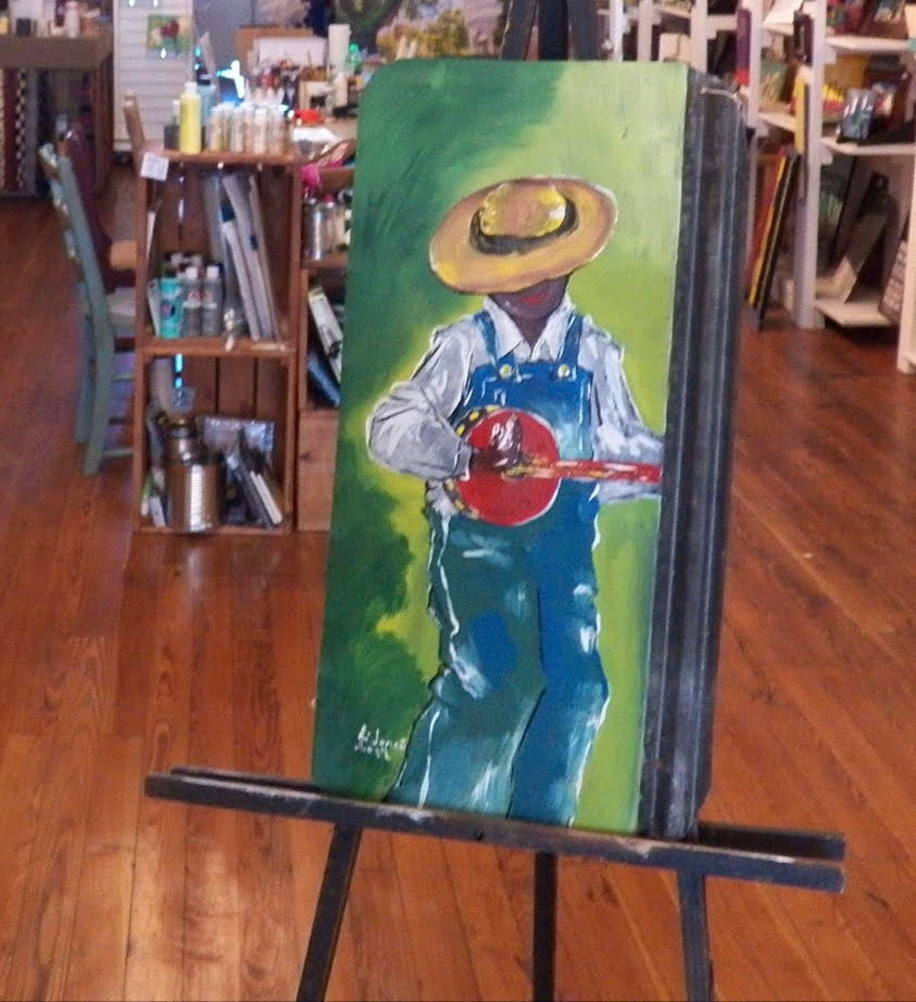"""Strumming the Blues"" is an example from the artist's musician series."