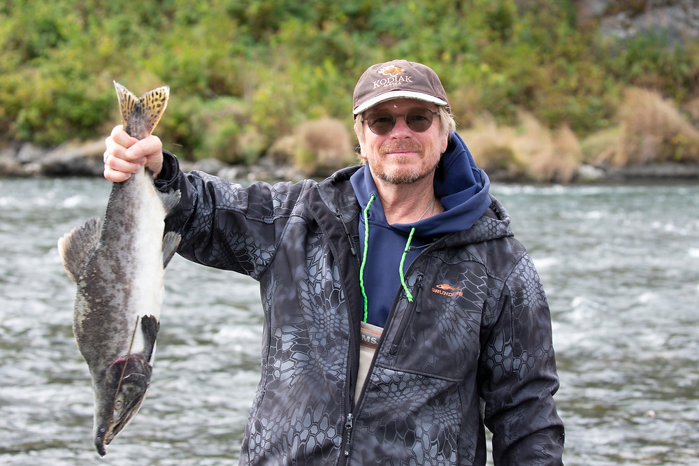 Danny Sullivan, husband of our Pro, holds his salmon proudly.