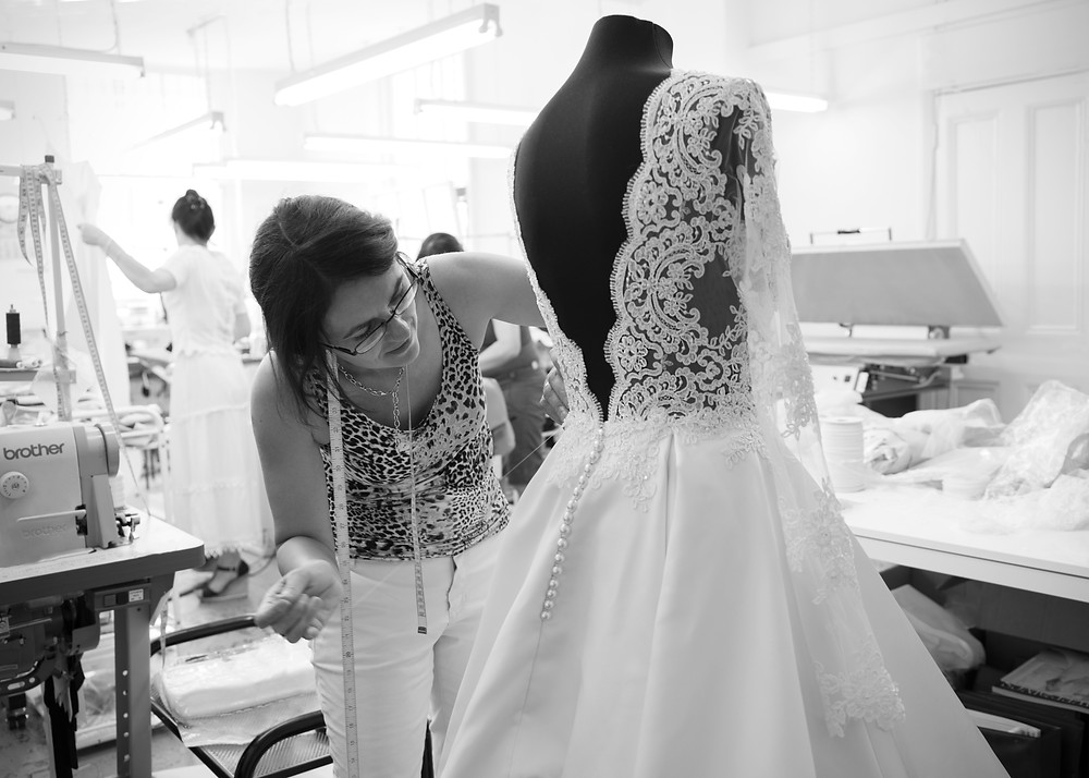 Handcrafting of lace and beading on a wedding dress