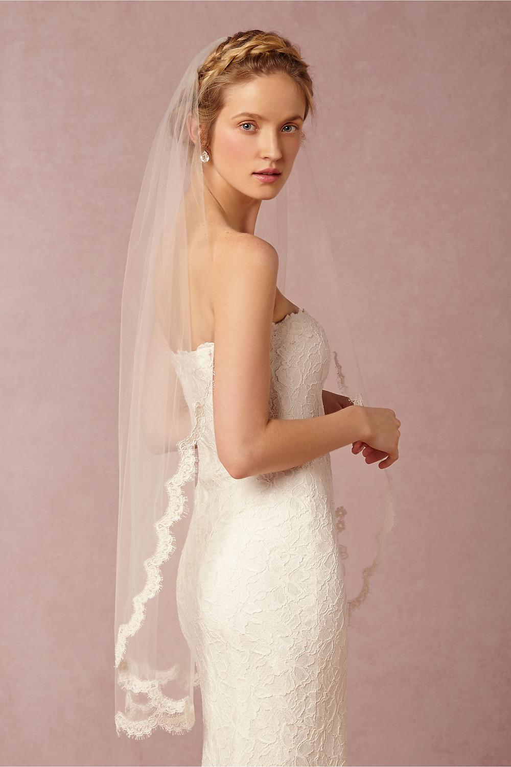 Bride wearing a fingertip veil