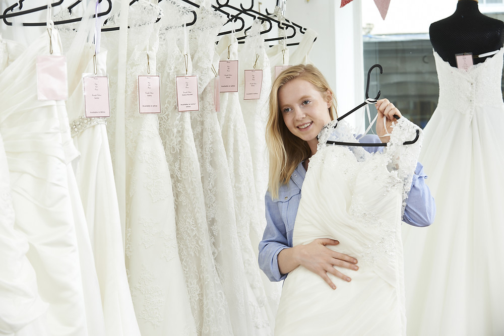 Retail Chain - Girl choosing a wedding dress