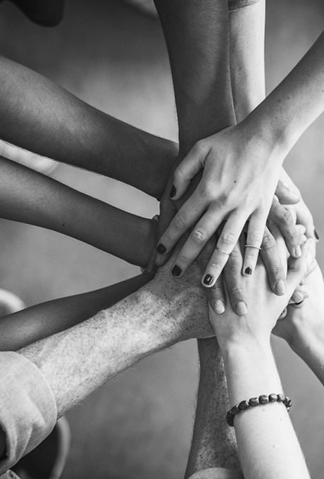 Stack Of Hands Showing Unity And Teamwork_edited.jpg