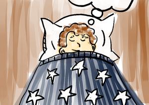 Menino deitado em cama sonhando