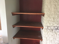 shelves by fireplace drywall meets stone
