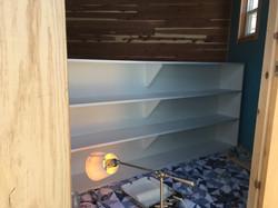 bookshelf fabricated and painted