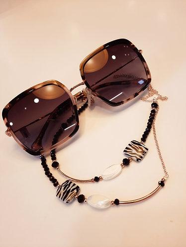 Chaîne à lunettes noire, blanche & dorée.