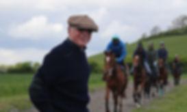 Owner Bob Jones on the gallops watching his horses