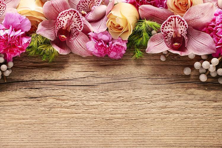 Floral arrangement with orchids, roses a