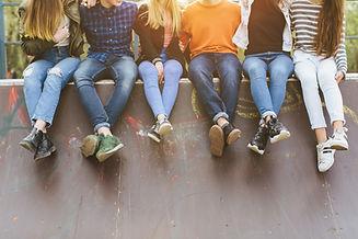 AdobeStock_207280112 (kids on a wall).jp