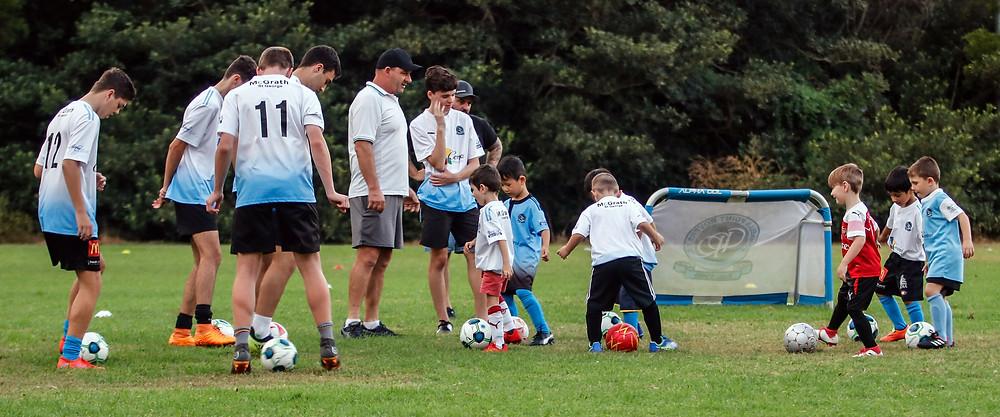 Adam Horne and a group of volunteers coaching u6's