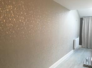 Metallic feature wallpaper applied