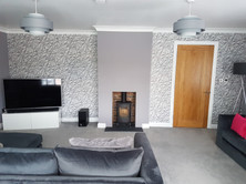 Feature wallpaper around fireplace