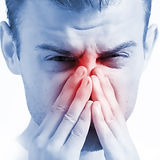 man with runny nose on white background,