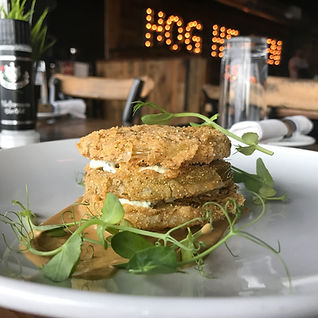 Fried green tomatoes with herbed goat cheese only at Southern Social