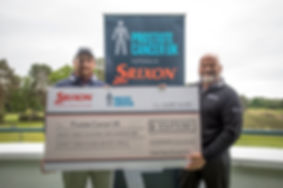 Shane Lowry receiving Prostate Cancer UK cheque