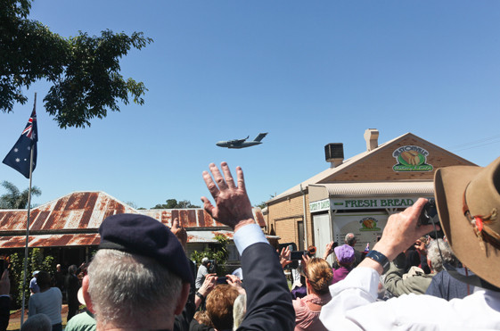 Veterans in the crowd wave at the passing Globmaster