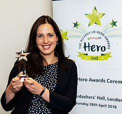 Patricia Herbert receiving award