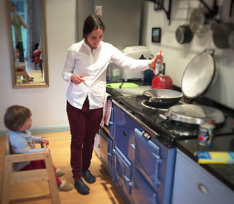 Patricia Herbert cooking with family