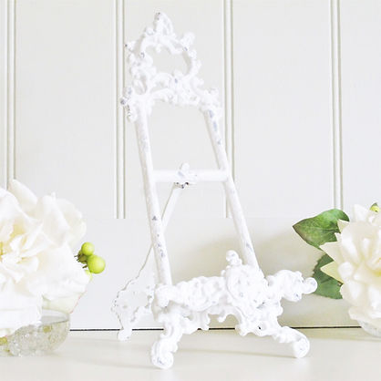 white ornate table easel