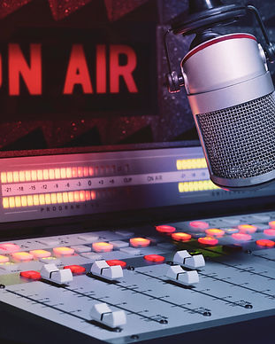 Professional microphone and sound mixer in radio station studio.jpg