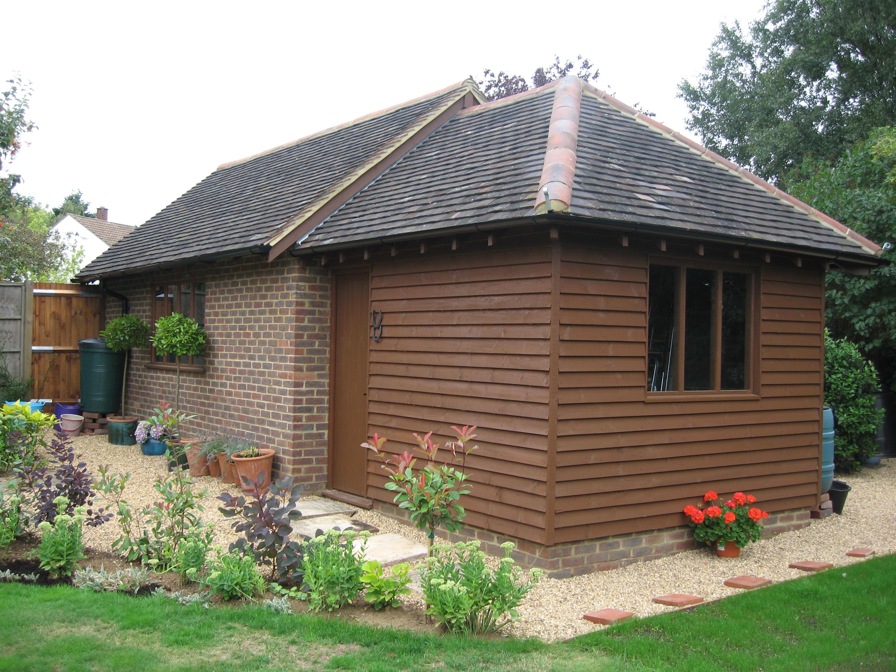 Detached garage with garden store