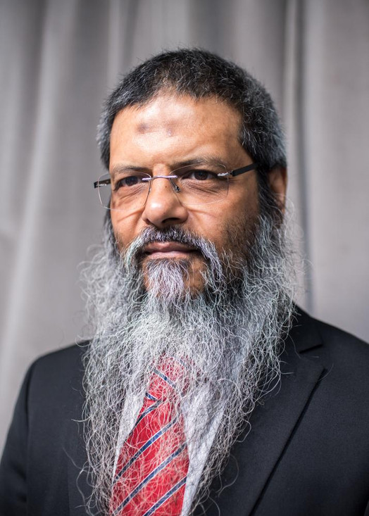 """Manwar Ali, was one of the first influential propagandists in the UK for a radical Islamist message. Active in the 1980s and 1990s, he helped to radicalise """"thousands"""" of young Muslims, encouraging many of them to travel to fight in wars in Afghanistan, Kashmir, Burma, Bosnia and Chechnya."""