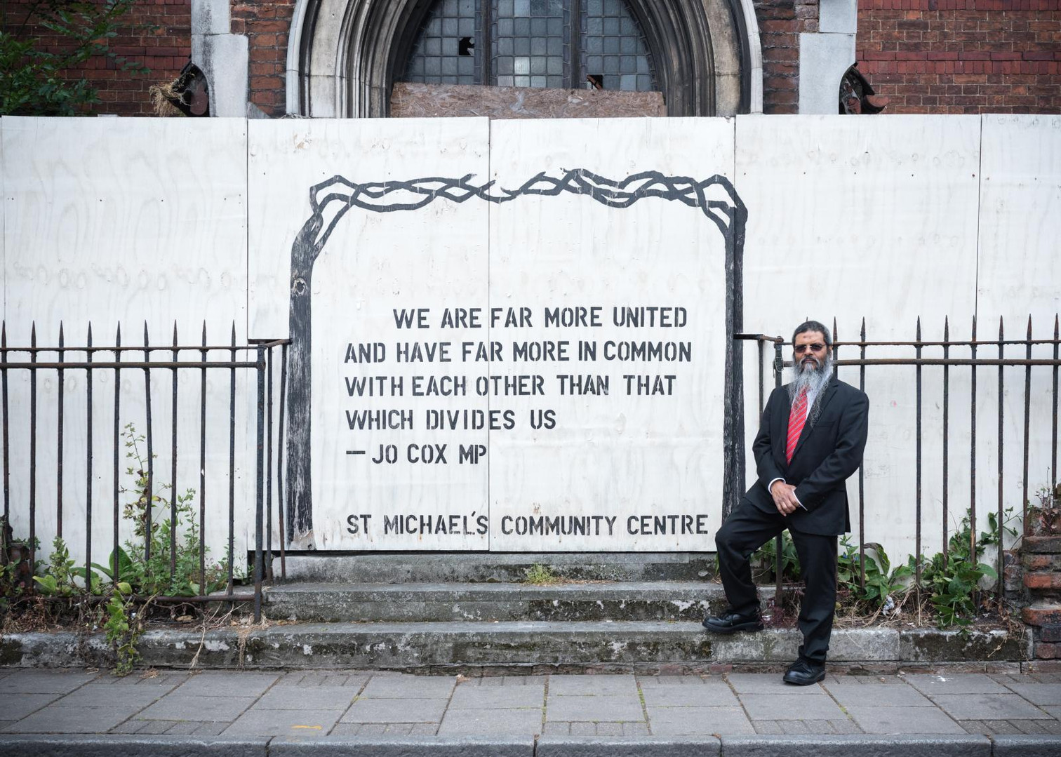 The sentence written on the wall of the construction site still open is by Helen Joanne Cox a british politician who served as the Member of Parliament (MP) for the Labour Party murdered by an far right-wing extremist during the Brexit campaign.