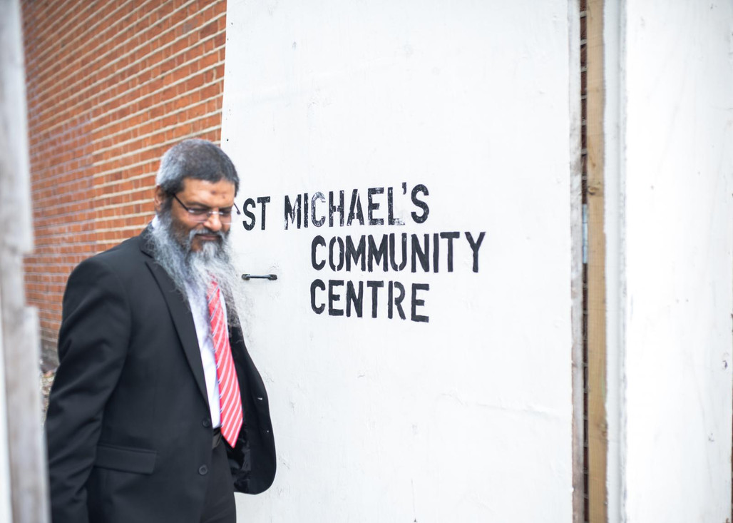 Manwar walks out of St. Michaels Community Center in Ipswich where he founded JIMAS, a Muslim educational charity which works to create greater understanding about Islam amongst Muslims and people of other faiths or none.