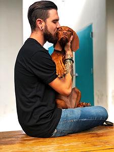 photo-of-man-kissing-his-dog-2745151.jpg