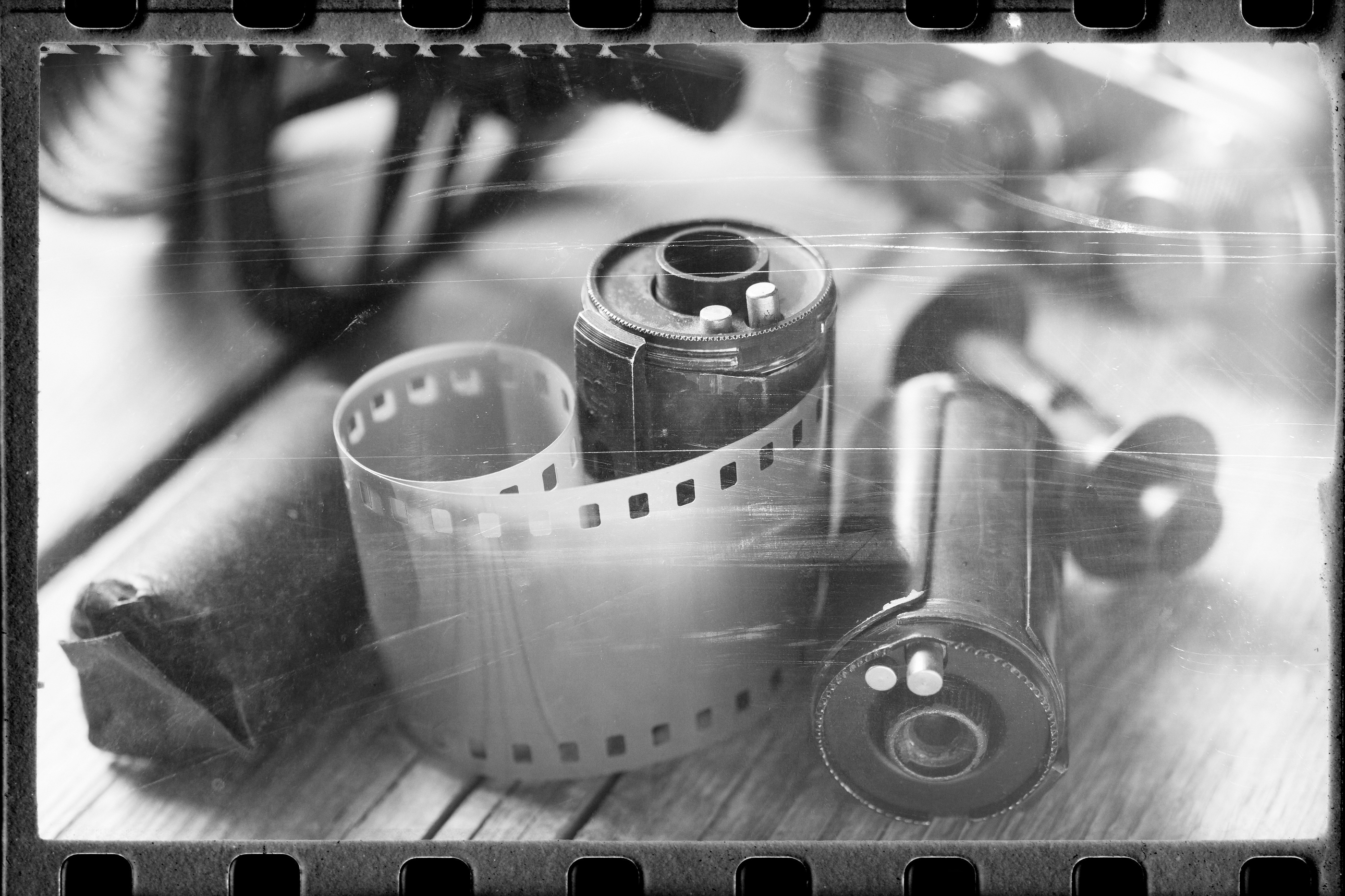 Old Film Stylized Photo Of Rolled Up Film, Cassette And Retro Camera. Vintage Effect.
