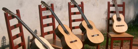 Take 4 guitars and chairs