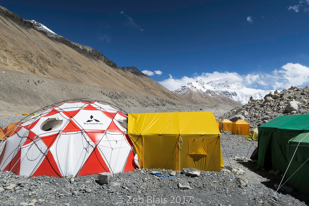The dining and lounge tent and vestibule. The small orange tents are shower and bathroom tents. Zeb Blais