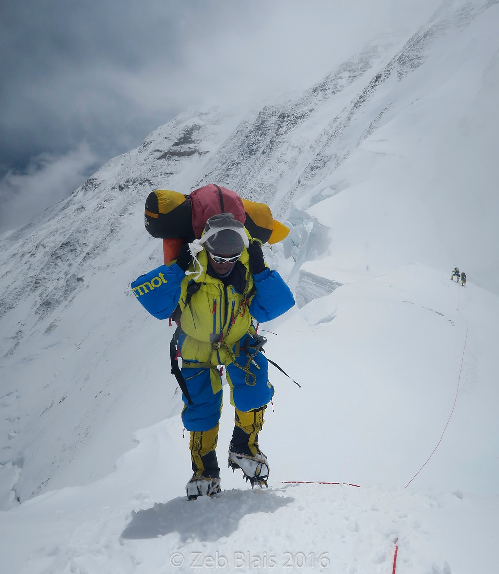 Mingma headed down from Camp 3 back to North Col with a huge load, Marmot Down Suit