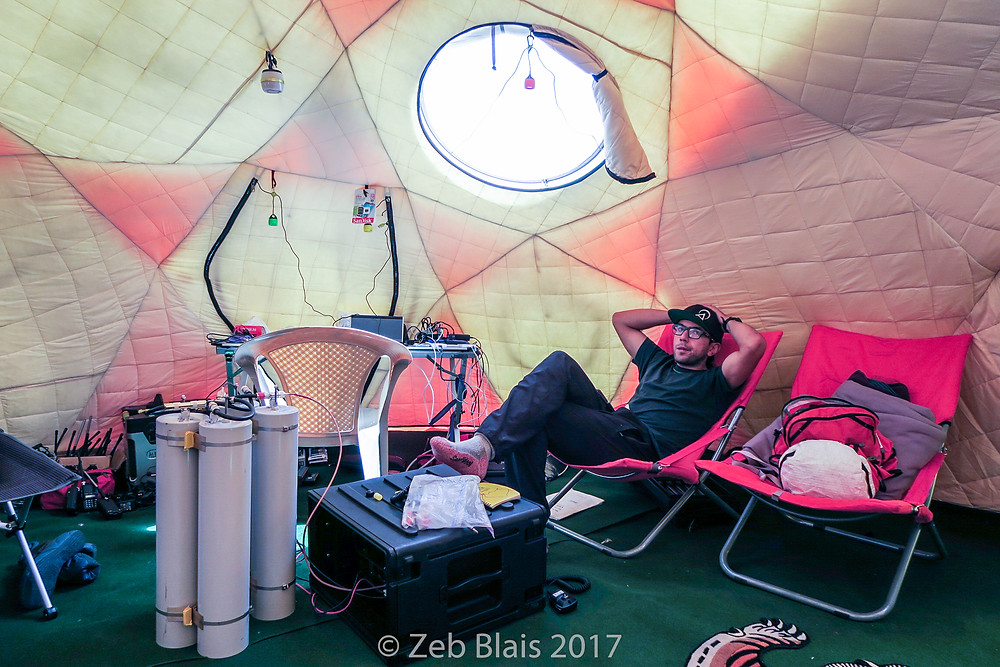 Mountain Guide Topo Mena relaxing behind our radio repeater and electronics station. Zeb Blais