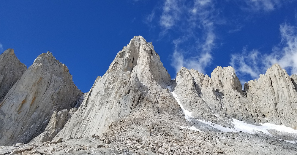Mount Whitney's East Buttress divides the sun from the shade just left of the snowy Mountaineer's Route.