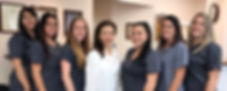 Dr. Kessy Lee with her staff at Kingston Family Cosmetic Dental Center in Cherry Hill, NJ