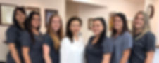 Dr. Kessy Lee with her staff at Kingston Family Cosmetic Dental Center.