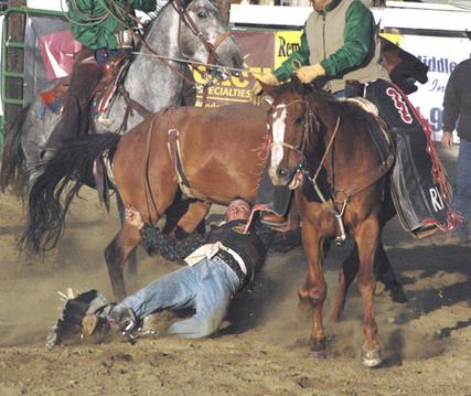 Bronc Rider Down Flying Heels.jpg