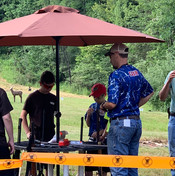 Coach Ben helping to get ready for the muzzleloader competition