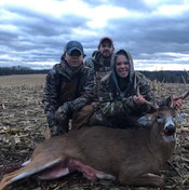 Logan, Evan and Coach Ben with Logan's 1st buck