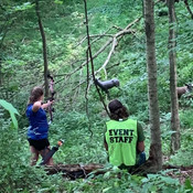 Kaylee taking aim in the woods