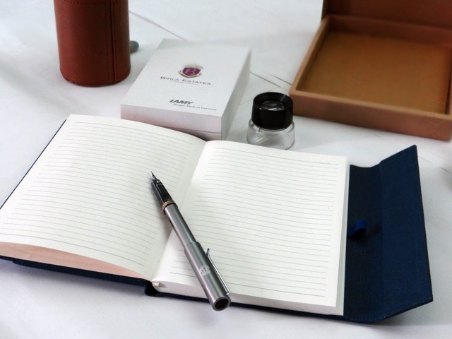 Birla Estates pad and pen - focus logo on pen